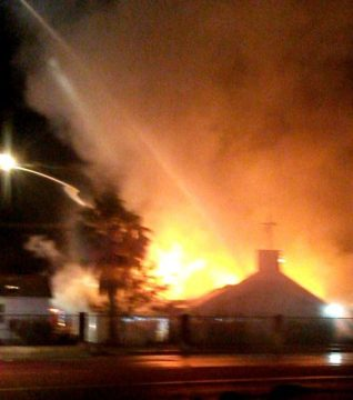 Firefighters are still battling the blaze at Community First Church of God in Homeland.