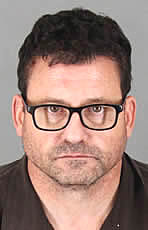 Andrew Pasqua  was arrested after a warrant service in Lake Elsinore.