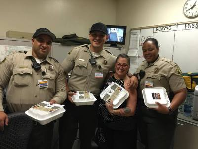 Vicki Nardone, hand-delivering Backyard BBQ Catering Company meals to deputies working at the jail ward of RCRMC.