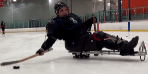 Sara joined in on the fun during her chilly day spent with the sled hockey team.