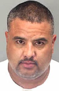 Rigoberto Villanuevo was arrested for murder and other charges.