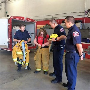 Sara got to try on fire turn-out gear and other equipment typically used by firefighters.