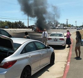 The small four-door car reportedly erupted flames within minutes of the initial collision. Michelle Lewis photo