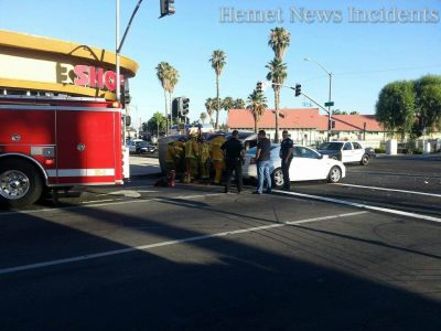 Firefighters work to extricate the driver from her rolled SUV. Oscar Ramirez photo