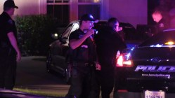 Officers complete their investigation at the termination of the dangerous pursuit. Miguel Shannon photo