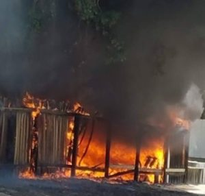 A fence was burning out of control as flames threatened to extend to the residence. Michelle Leigh Leaverton photo