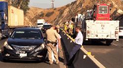 A CHP officer talk to one of the people involved in the fatal accident. William Hayes photo