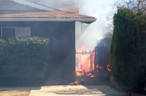 First arriving firefighters reported finding a fence, tree and two homes beginning to burn. Hemet Fire Department - Joe Fanaselle photo
