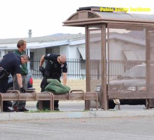 "Hemet police officers detained a man after he threatened to ""scalp"" another person at a bus stop."