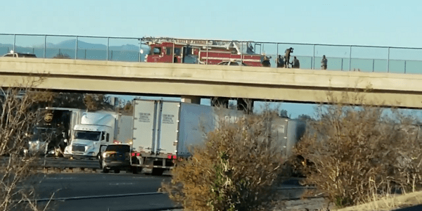 UPDATE: I-215 re-opened after officials coax suicidal woman to safety