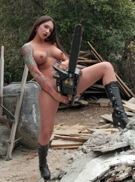 dangerous-busty-tattoo-beauty-with-chainsaw-580x870