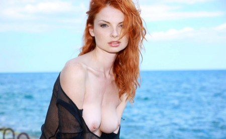 fiery-redhead-girl-strips-naked-at-the-beach-3