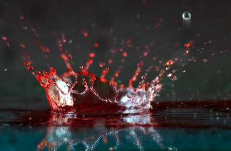 Close Up of Red and Clear Liquid Splash Crown