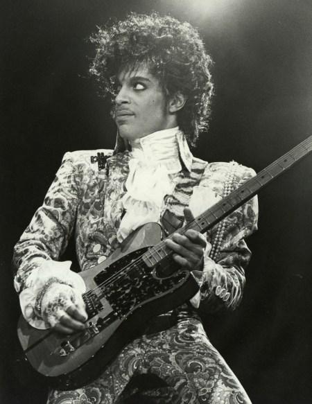 1-prince-passport-photo-holding