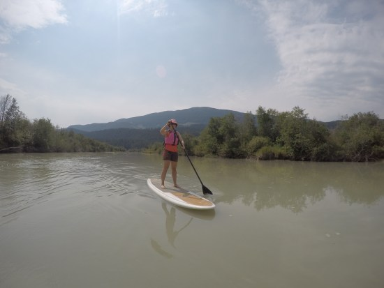 women stand up paddleboarding down the Columbia River