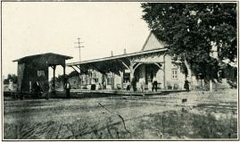 Riverton's first railroad station opened in 1863 and once stood facing the tracks, close to today's site of the Riverton War Memorial. Railroad agent Charles Mattis lived in the house adjacent to the station and served as Riverton's first postmaster when the first Riverton Post Office was established in 1871. PHOTO CREDIT: The New Era, 1909 Christmas Issue, p.23