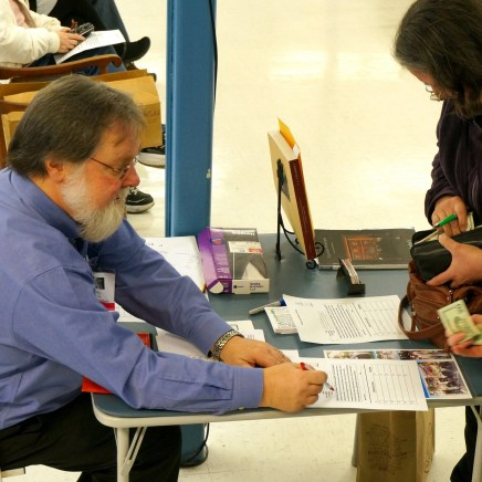 HSR President Gerald Weaber checks in people with appraisal items.