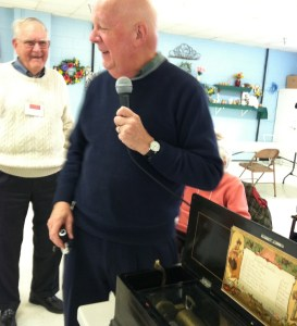 Expert Personal Property Appraiser, Ronald Shaffer, ISA assesses Nancy and Bill Hall's music box.