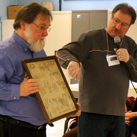 Mike Maratea (r.) describes details on a family ancestor's sampler.
