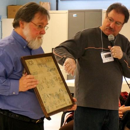 Mike Maratea (r.) describes details on a family ancestor's sampler.