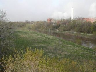 North view of river valley from the west side of the North Avenue bridge, across from the Hometown site. Wisconsin Paperboard is the industrial complex in the background.