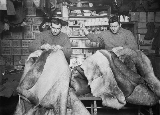 Edgar (Taff) Evans and Tom Crean repair sleeping bags at Scott Hut.