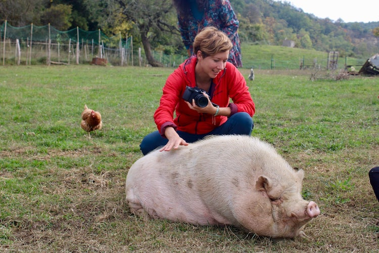 Charlotte with a pig