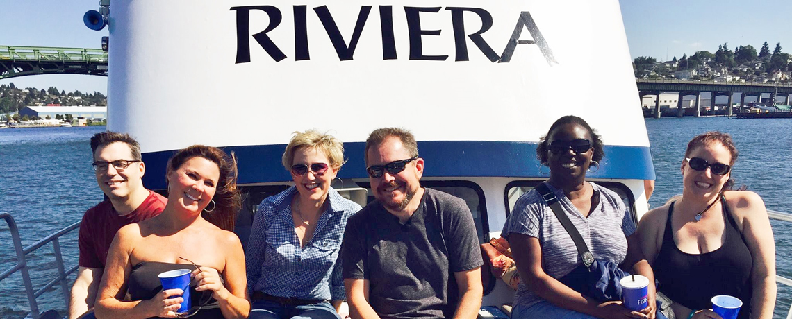 Seattle Riviera Boat Cruises 4 – People in front of Riviera sign