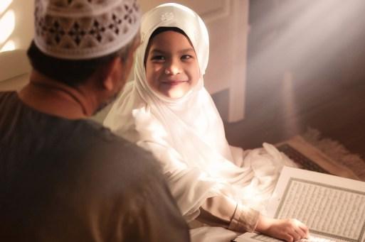 A shaikh teaching a kid the Quran with fun