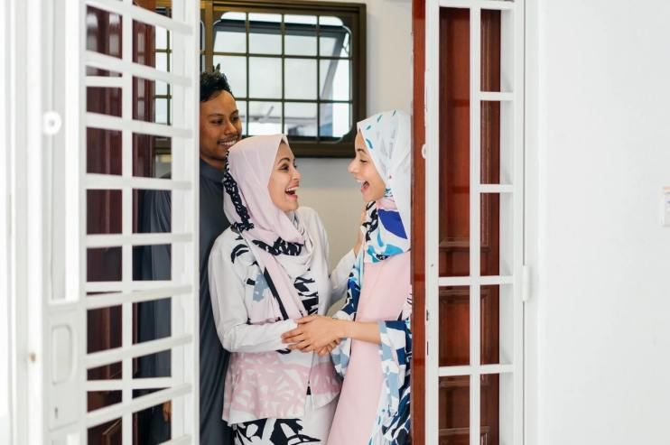 Two Muslim women talking