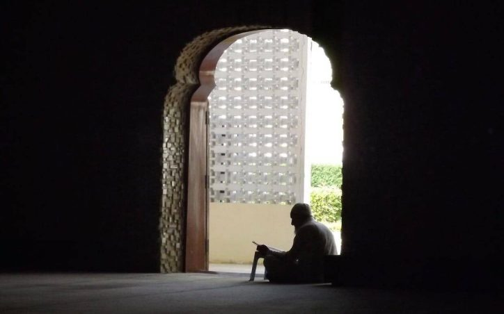 A man reciting Quran in the mosque