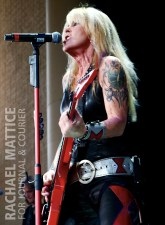 """Lita Ford opens for Poison and Def Leppard for the """"Rock of Ages"""" tour at Klipsch Music Center in Noblesville, Ind. on August, 24, 2012. (Photo by Rachael Mattice/Journal & Courier)"""