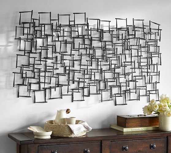 pottery barn living room sofas wall color for with brown furniture forged metal sculpture |