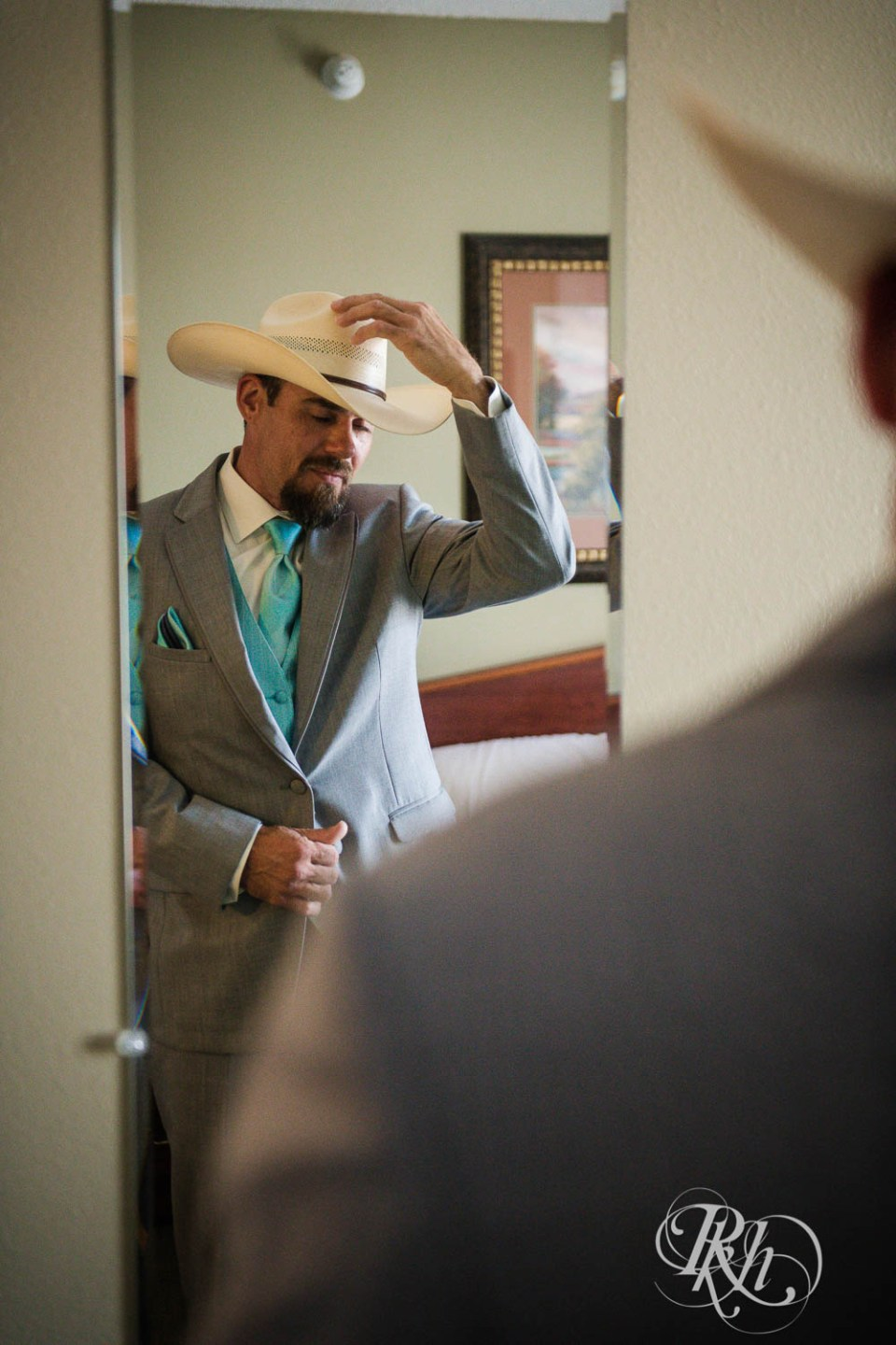 Groom with cowboy hat