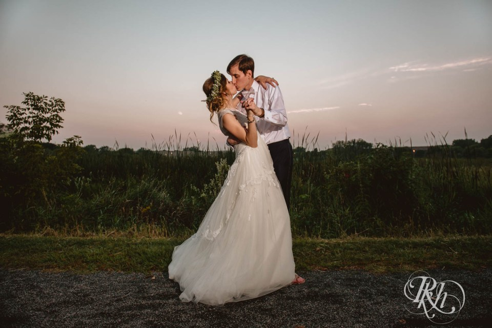 Bride and groom kissing during blue hour