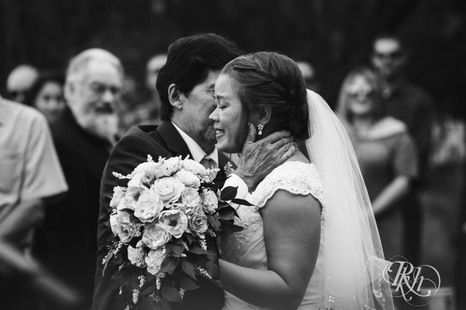 father kissing bride