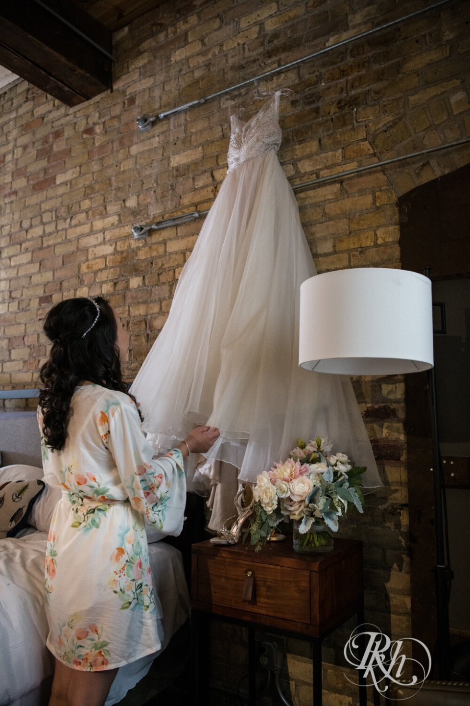 Bride looking at wedding dress.