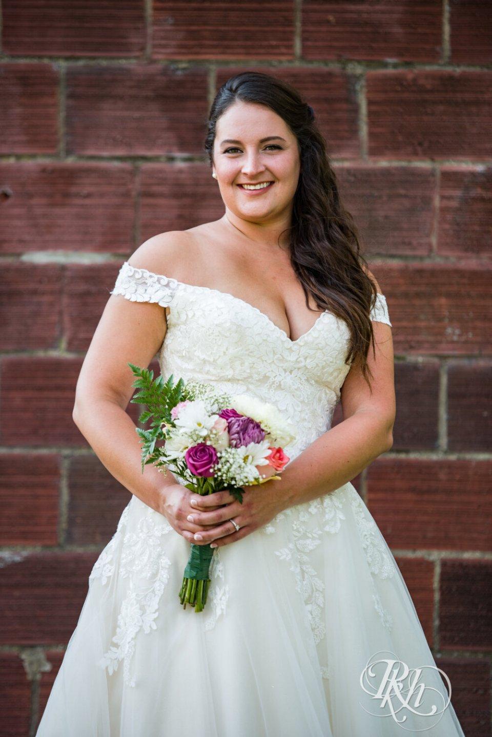 Jolene, the bride, holding flowers