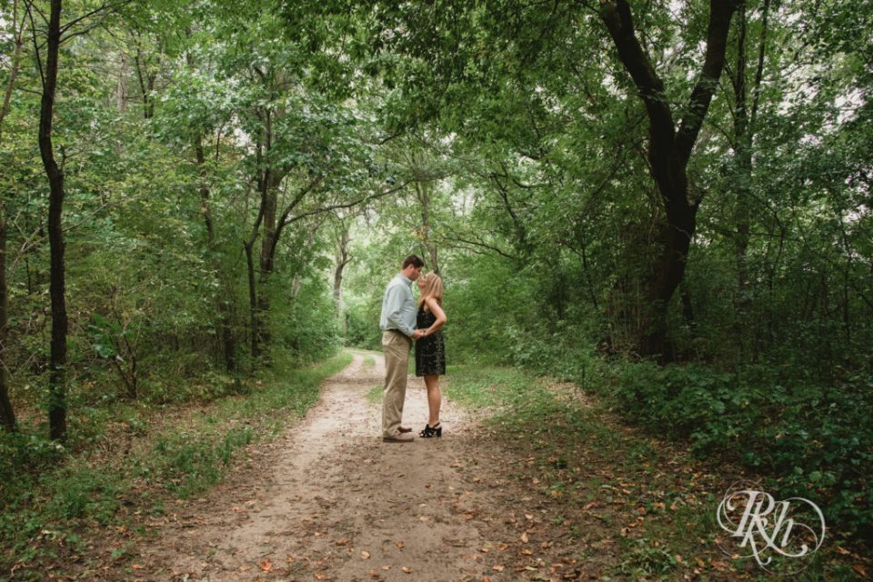 Couple kisses in woods