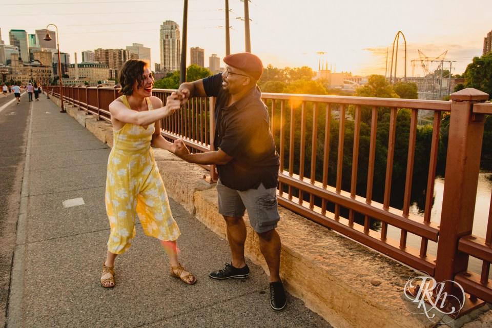 sunset photography stone arch bridge couple laughing