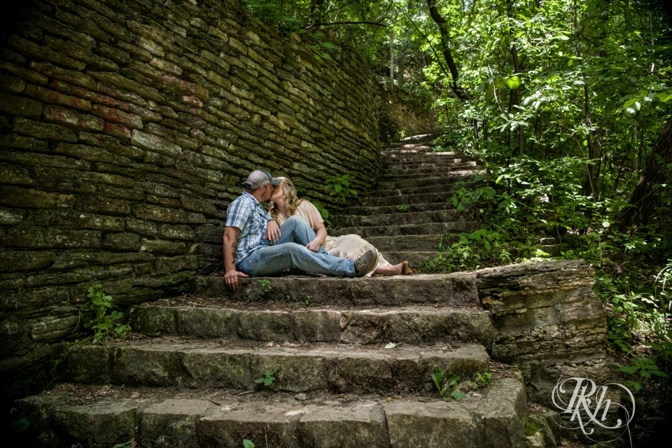 summer engagement photography couple kissing on stairs