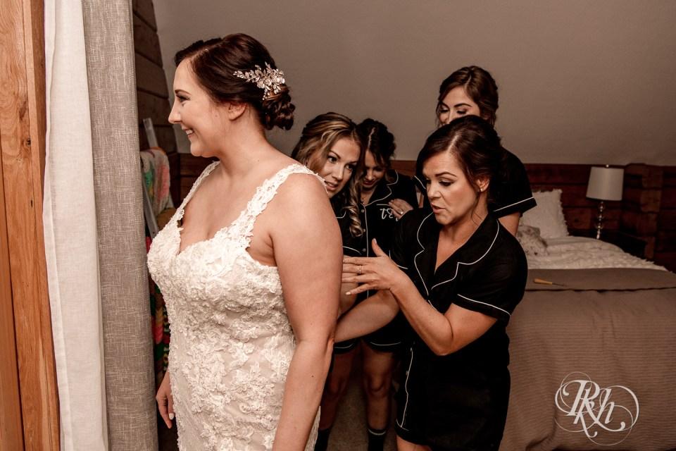 Cabin Wedding bridesmaids helping bride