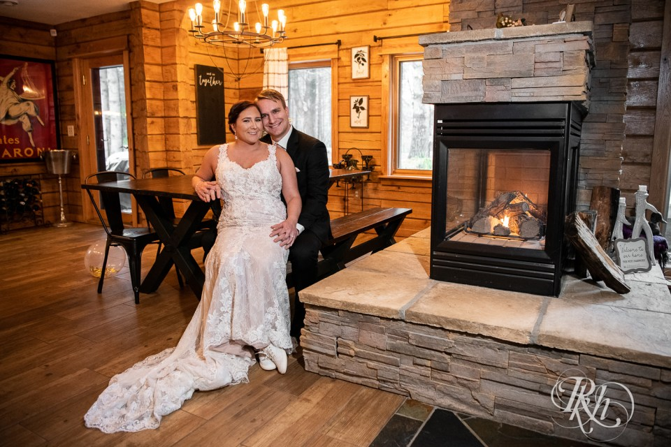 Cabin Wedding couple by fireplace