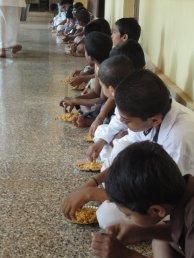 Boys enjoying breakfast