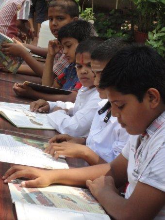 Boys engrossed in reading