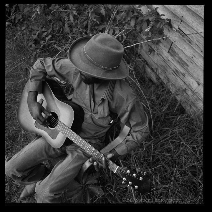 RL Boyce plays guitar in his yard in Como, MS. photo © Bill Steber