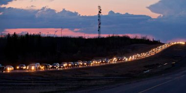 Traffic lines the highway as residents leave Fort McMurray, Alta., on Tuesday May 3, 2016. A wildfire has put all of Fort McMurray under a mandatory evacuation order which means that about 70,000 people who live in Fort McMurray are being told to flee the city. THE CANADIAN PRESS/Jason Franson