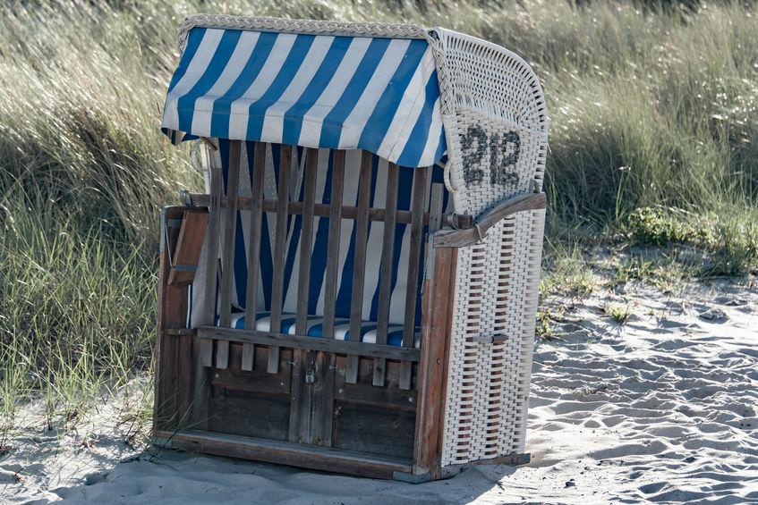 99870798 - old beach chair on the sand on the beach