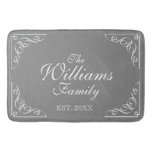 Family Name Est. grey bath mat with elegant swirls