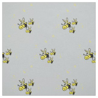 Three bees with a soft blue background